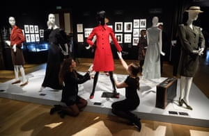 Staff prepare a display of items from the sale of Audrey Hepburn's personal collection at Christie's in London