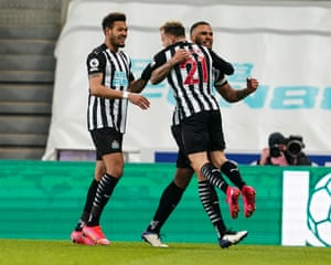 Jamaal Lascelles is congratulated by his team mates after putting Newcastle United ahead.