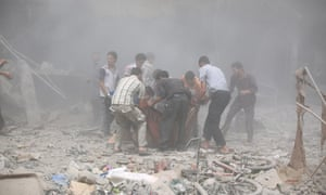 People carry the wounded to hospital after the air strike on Douma.