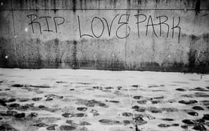 "Graffiti ""RIP LOVE Park"" and footprints in snow."