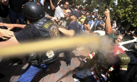 Pepper spray is used as anti- and pro-Donald Trump protesters clash.