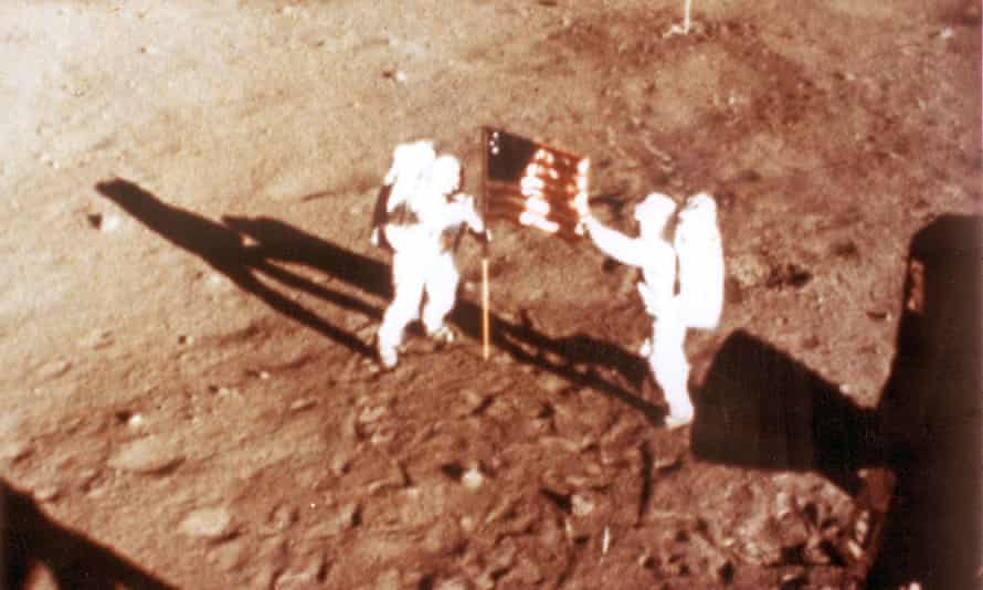 Neil Armstrong and Buzz Aldrin deploy the US flag on the lunar surface during the Apollo 11 lunar landing mission.