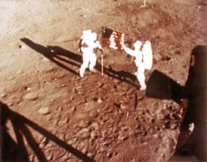 Neil Armstrong and Buzz Aldrin plant the US flag on the moon in 1969