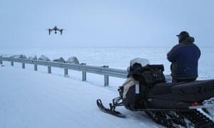 Dennis Davis flies his drone by the edge of Shishmaref.