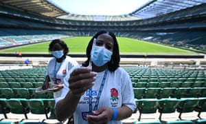 Covid vaccination staff with a Pfizer jab at Twickenham rugby stadium in London.