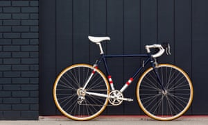 State Bicycle Co 4130 retro steel frame leaning against a blue wall