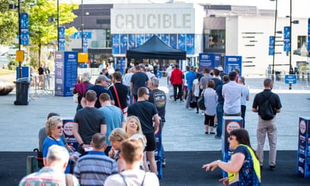 Fans queue for entry to the Crucible in Sheffield on Friday.