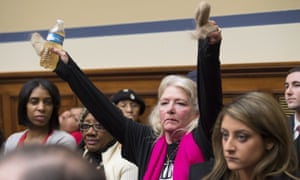 Glaydes Williamson protests at a government meeting on Capitol Hill in Washington by holding up a bottle of water from Flint, Michigan. Over 100,000 residents of Flint were potentially exposed to high levels of lead in drinking water. A federal state of emergency was declared in January 2016 and Flint residents were instructed to use only bottle or filtered water for drinking and bathing.