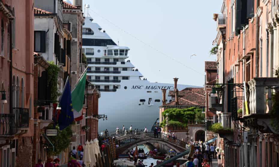 A cruise ship towering over a canal in Venice, June 2019