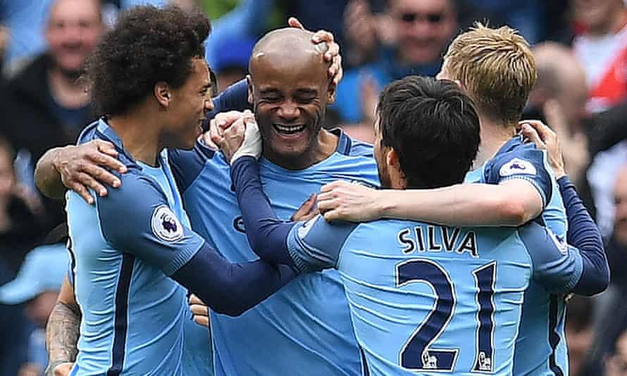 Vincent Kompany celebrates scoring his Man City's second goal against Crystal Palace.
