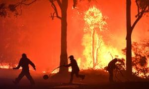 Firefighters tackle an inferno near Murramarang in December.