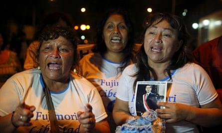 Alberto Fujimori supporters celebrate outside Centenario hospital in Lima on 24 December.