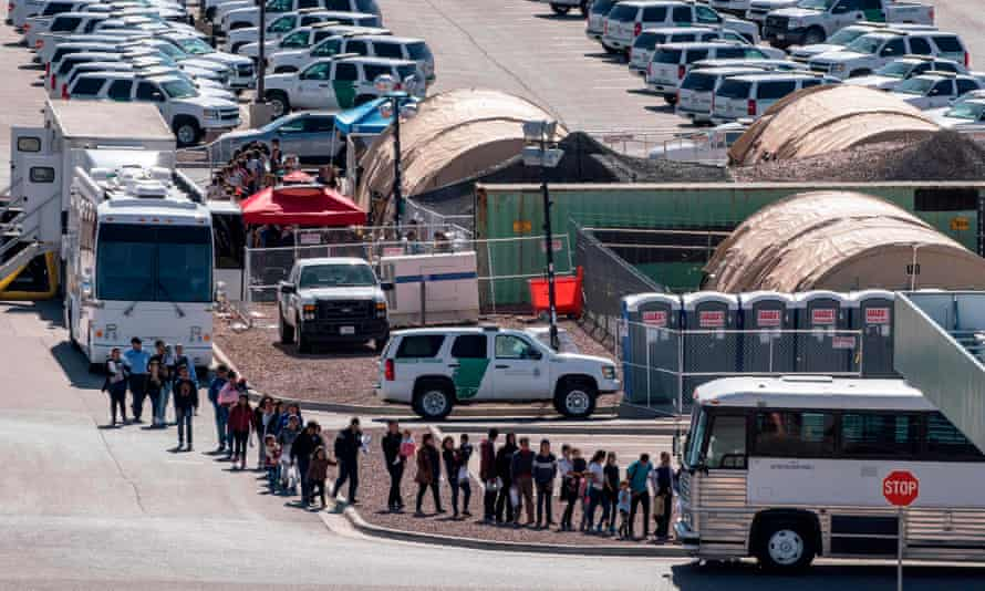 Migrants board buses to take them to shelters after being released from migration detention in El Paso, Texas on 27 April 2019.