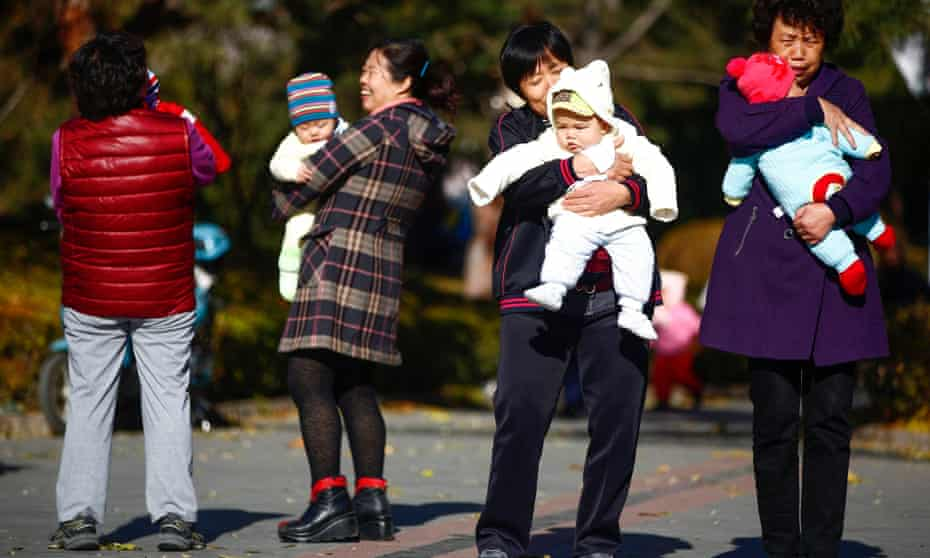 Chinese parents and babies in a Beijing park