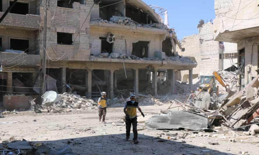 Rescue workers at the site of a reported Russian airstrike in the Maarat al-Numan district of Idlib.