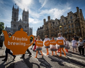 'Human teabags' protest outside Sainsbury's AGM in London on Wednesday.