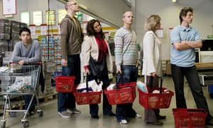 People queuing at supermarket checkout