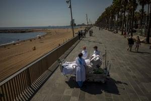 Man in hospital bed by seaside