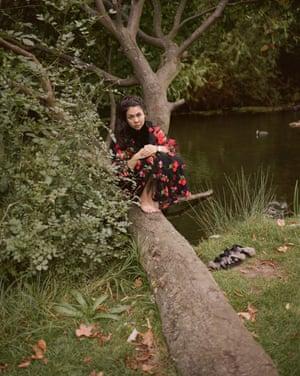 Simone Rocha sitting on a fallen tree