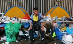 A protester rests during the demonstration against the proposed extradition bill