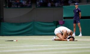 Raducanu drops to her knees after winning her third round match against Cirstea.
