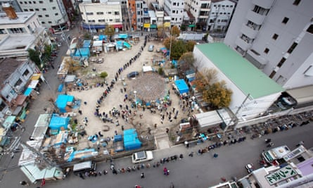 A soup kitchen set up for local homeless people in 'Square Park', Osaka.