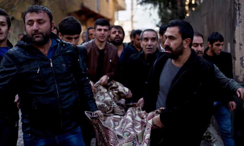 Kurds carry the body of a man killed during fighting with security forces in Sirnak, south-eastern Turkey, on Sunday 10 January.