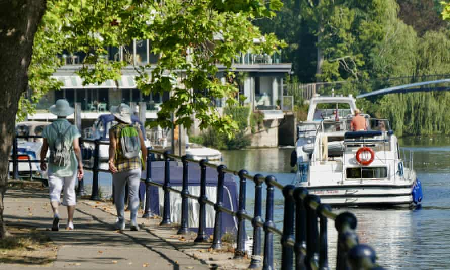 People walking beside the River Thames at Ray  Mill Island and Boulter's Lock, near Maidenhead, Berkshire