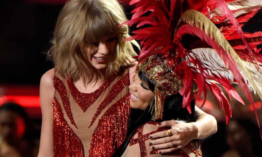 Taylor Swift and Nicki Minaj share a hug onstage during the MTV Video Music Awards.