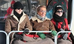 Anne Hathaway and husband Adam Shulman skiing in Gstaad, Switzerland with Valentino Garavani.