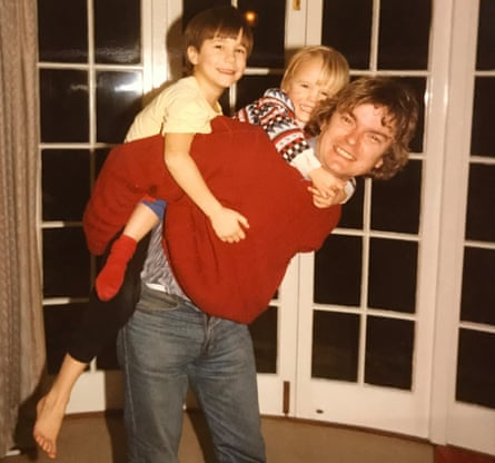 From left to right: James and David Challen with their father Richard at home in Ruxley Ridge, Claygate
