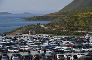 Cars fill the parking lot at Diamond Valley Lake, one of the hotspots where thousands arrive to see the wild flowers