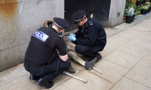 Police in Manchester assist a man who has taken spice