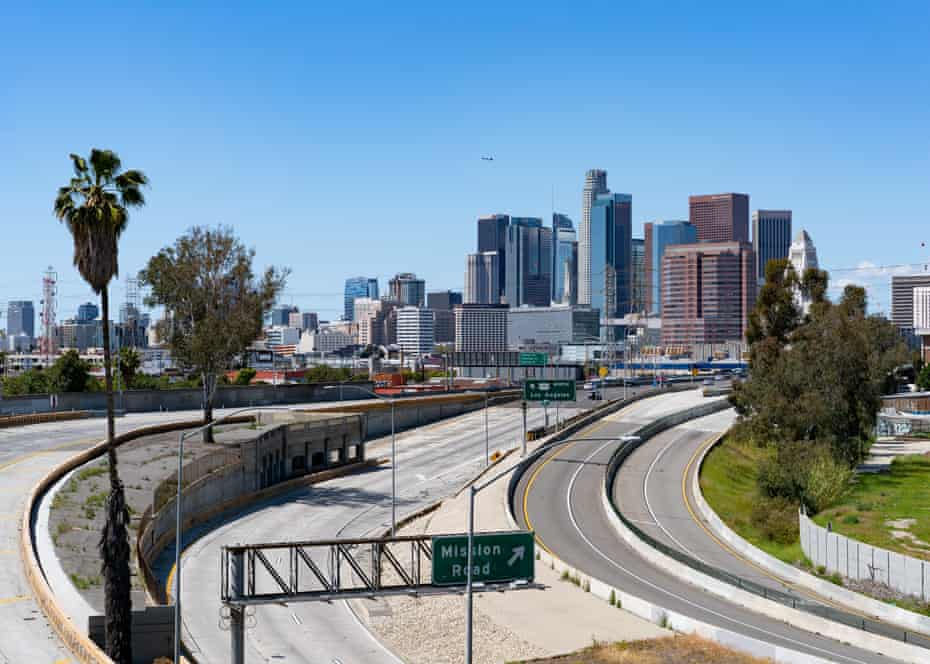 Freeways are empty during afternoon rush hour in Los Angeles after a shelter-in-place order.