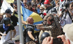 White nationalist demonstrators clash with counter demonstrators at Lee Park in Charlottesville, Virginia, on 12 August 2017 .