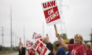 United Auto Workers members, including LeAnn Cramer, right, picket outside of the General Motors Lansing Delta Township plant on Monday.