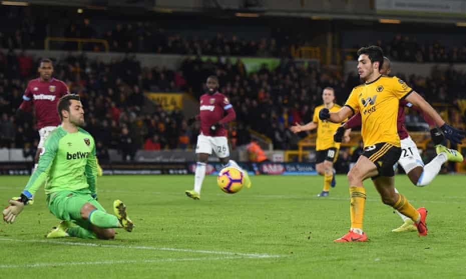 Raúl Jiménez dinks the ball over West Ham's keeper Lukasz Fabianski for Wolverhampton Wanderers third goal.