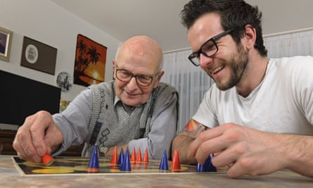 Two men playing a board game.