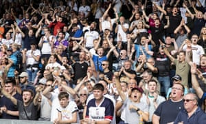 The Bolton Wanderers supporters applaud their team