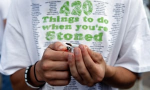 Tyler Shumway of Aurora, Colorado, lights up a joint at 420pm in Civic Center Park on 20 April 2012 in Denver.