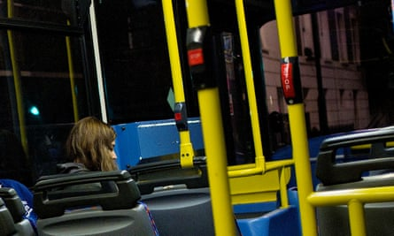 woman sitting alone in bus at night
