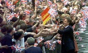 Prime minister Tony Blair, is greeted by a sea of flag-waving well-wishers in Downing Street, 2 May 1997