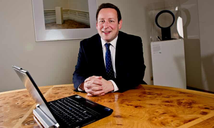 Ed Vaizey, Conservative MP and former culture minister, sitting a desk with a laptop on it