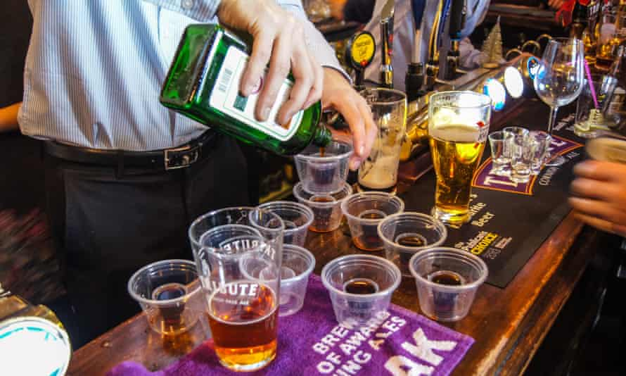 A barman pouring Jägerbombs. If you reduce the sedative effects of alcohol by consuming energy drinks, you're going to feel more awake and perhaps think you're less impaired than you are.
