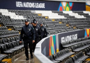 Police patrol the Estádio D Afonso Henriques stadium in Guimarães before England's Nations League semi-final defeat against the Netherlands.