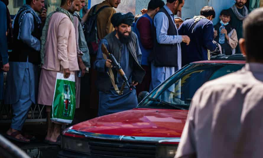 Taliban fighter with AK47 shouting at driver of car