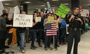 People protest at Washington Dulles airport.