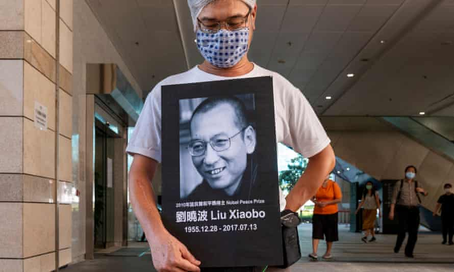 An activist holds a portrait of Chinese dissident and Nobel peace prize recipient Liu Xiaobo after attending a court in Hong Kong for marking the anniversary of the Tiananmen Square massacre.