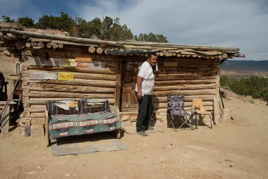 Edison Johnson steps outside his home on the Navajo Nation, south of Shiprock.