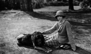 Rose MacaulayEnglish novelist, essayist and travel writer Rose Macaulay (1881 - 1958) sitting with bloodhound dog in the garden of Michael Sadleir (formerly Sadler). Original Publication: People Disc - HH0262 (Photo by Sasha/Getty Images)